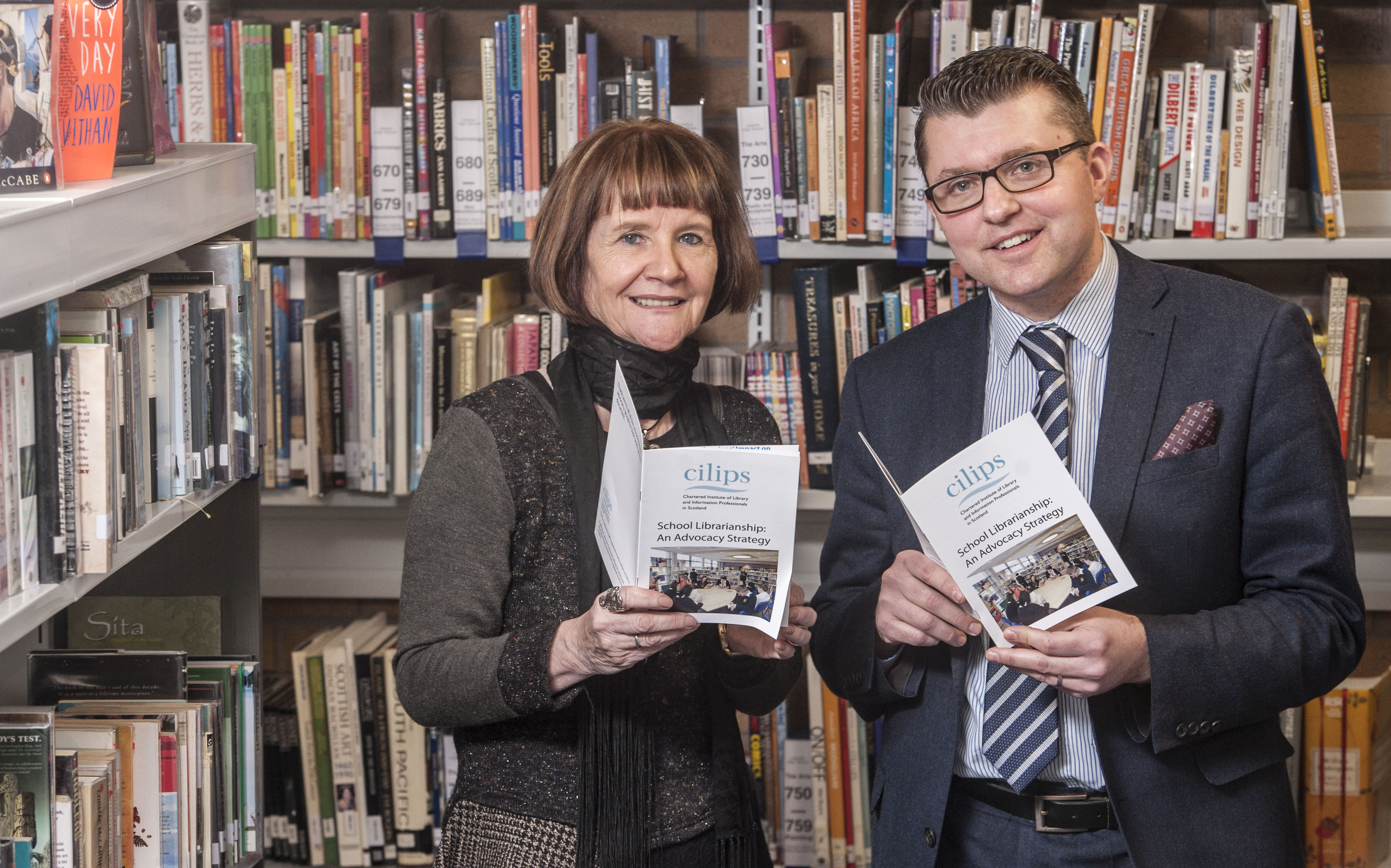 School Librarian Duncan Wright and author and CILIPS Vice President Theresa Breslin with the document that highlights the role of school librarians in the promotion of literature, literacy and more. PIC: PHIL WILKINSON